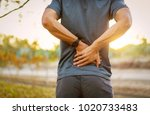 back pain  close up young man... | Shutterstock . vector #1020733483