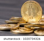bitcoin on wooden table top   Shutterstock . vector #1020734326
