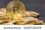 bitcoin on wooden table top   Shutterstock . vector #1020734329