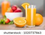 orange juice in glass | Shutterstock . vector #1020737863