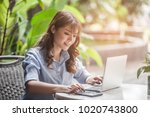 a business woman sitting and... | Shutterstock . vector #1020743800