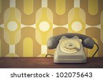 old fashioned phone on vintage... | Shutterstock . vector #102075643