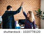 caucasian colleagues give each... | Shutterstock . vector #1020778120