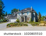 luxury house at sunny day in... | Shutterstock . vector #1020805510