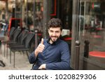 handsome male model looking at... | Shutterstock . vector #1020829306