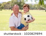 young happy father carrying on... | Shutterstock . vector #1020829894