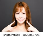 closeup smiling  young woman... | Shutterstock . vector #1020863728