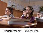 Elementary aged pupils listen to the teacher - stock photo