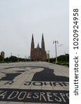 Small photo of La Plata cathedral outdoors view with graffiti on the floor of the square, December 2, 2017, Argentina