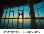the two men handshake in the... | Shutterstock . vector #1020928849