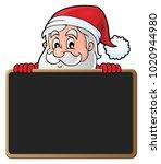 santa claus with blackboard... | Shutterstock .eps vector #1020944980