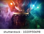 the musician plays the bongo on ... | Shutterstock . vector #1020950698