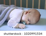 tired  sleeping baby on blue... | Shutterstock . vector #1020991534