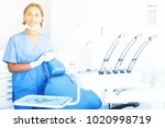 female dentist is meeting next... | Shutterstock . vector #1020998719