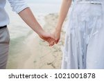 bride and groom are holding... | Shutterstock . vector #1021001878