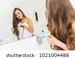 Smiling Woman Straightening...