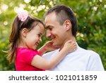 portrait of little girl hugging ... | Shutterstock . vector #1021011859