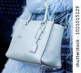 a bright bag in women's hands.... | Shutterstock . vector #1021015129