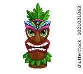 hawaiian totem with palm leaves.... | Shutterstock .eps vector #1021021063