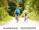 active young couple biking on a ... | Shutterstock . vector #1021026343