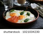 two fried eggs with fresh... | Shutterstock . vector #1021034230