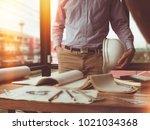 engineer holding white helmet... | Shutterstock . vector #1021034368
