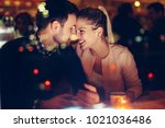 romantic couple dating in pub... | Shutterstock . vector #1021036486