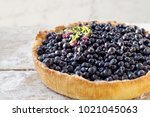 blueberry pie on the wooden... | Shutterstock . vector #1021045063