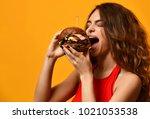 woman eat burger sandwich with... | Shutterstock . vector #1021053538
