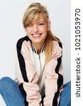 winking varsity babe sitting in ... | Shutterstock . vector #1021053970