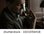 the man is trying a drink. aroma | Shutterstock . vector #1021056418