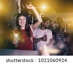 nice man and woman on party in... | Shutterstock . vector #1021060924