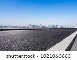 empty road with panoramic... | Shutterstock . vector #1021063663