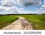 a rural road with pits and...   Shutterstock . vector #1021096300