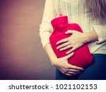 painful periods and menstrual... | Shutterstock . vector #1021102153