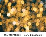 golden blur background.... | Shutterstock . vector #1021110298