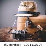 vintage case  hipster hat  and... | Shutterstock . vector #1021110304