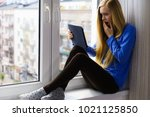 long hair teen girl on window... | Shutterstock . vector #1021125850