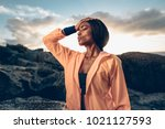 african woman standing with her ...   Shutterstock . vector #1021127593