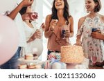 group of women at a baby shower ... | Shutterstock . vector #1021132060