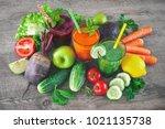 various freshly squeezed fruit... | Shutterstock . vector #1021135738