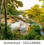 agua azul waterfall near... | Shutterstock . vector #1021138360