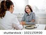 beautiful young brunette woman... | Shutterstock . vector #1021153930