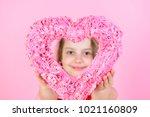 happy girl looking through rosy ... | Shutterstock . vector #1021160809