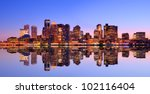 Financial District of Boston, Massachusetts viewed across from Boston Harbor. - stock photo