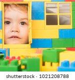 kid looking through door of toy ... | Shutterstock . vector #1021208788