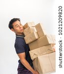 young man carrying a box  of...   Shutterstock . vector #1021209820