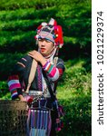 Small photo of young asian lady,Akha hill standing on the mountain in the morning, Chiang Rai Thailand