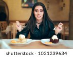 funny girl trying to decide... | Shutterstock . vector #1021239634
