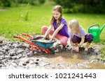 two funny little girls playing... | Shutterstock . vector #1021241443